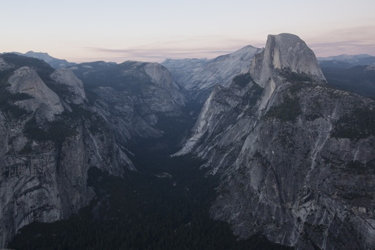Image: Dusk settles on Half Dome and Yosemite Valley in Yosemite National Park, California