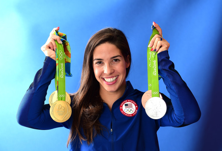 Maya DiRado of the United States poses with her four medals on the Today show