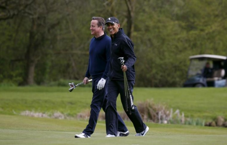 U.S. President Barack Obama plays golf with British Prime Minister David Cameron at The Grove golf course in Watford