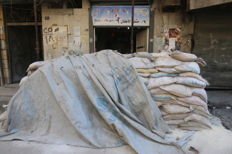 Image: Sandbags are pictured at the entrance of a children's hospital, near the site of recent airstrikes, in a rebel held area of Aleppo