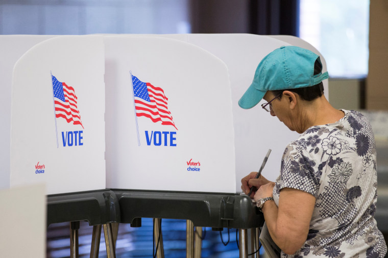 Image: A woman casts her vote in the 2016 Maryland Primary Election