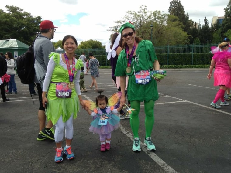 Hau and his wife, Lavinia Lim, who is an anesthesiologist, at a Disneyland Marathon with their 20-month-old daughter, Audrey