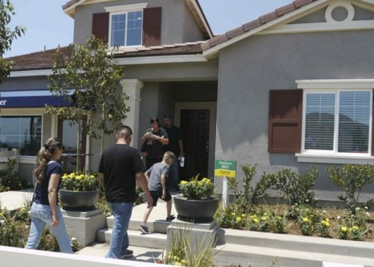 Prospective home owners tour a community being developed by builder D.R. Horton in Jurupa Valley, California