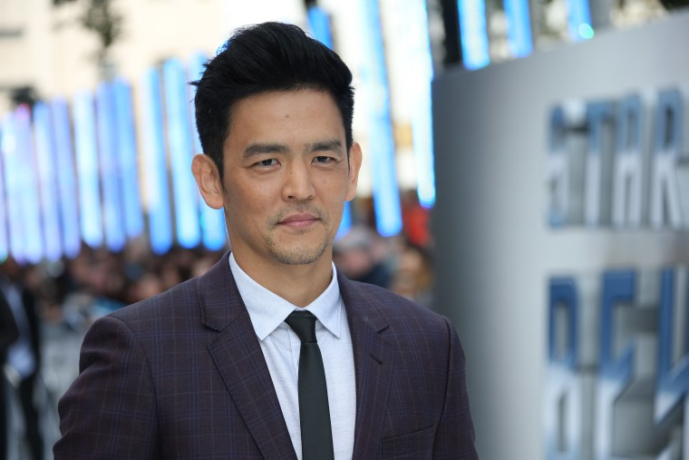 Actor John Cho poses for photographers upon arrival at the premiere of the film 'Star Trek Beyond' in London.