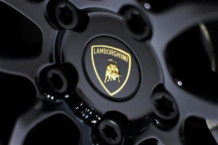A Lamborghini logo is pictured at the exhibition stand of Lamborghini during the second media day of the 80th Geneva Car Show at the Palexpo in Geneva