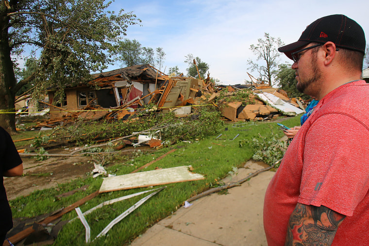 Tom Williams looks at his tornado damaged home in Kokomo, Ind., Wednesday, Aug. 24, 2016.