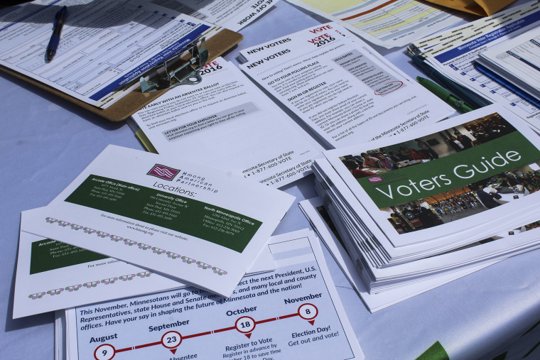 Image: Voter registration groups target Asian-Americans at a Hmong festival in St. Paul