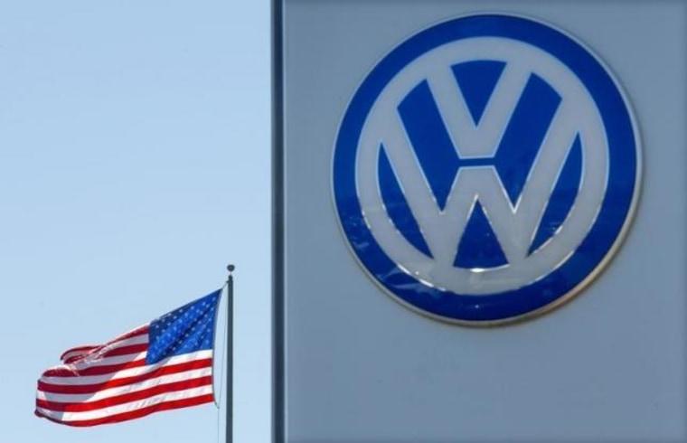 An American flag flies next to a Volkswagen car dealership in San Diego, California