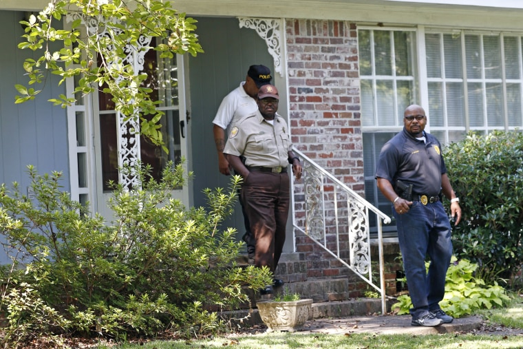Local police officers leave the Durant, Miss., home of two slain Catholic nuns on Aug. 25.