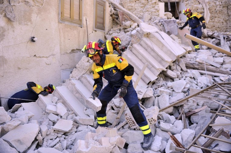 Image: Firefighters work in Pescara del Tronto