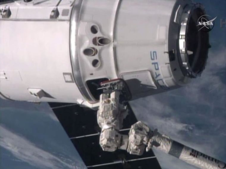 Astronauts onboard the International Space Station successfully capture the SpaceX Dragon spacecraft