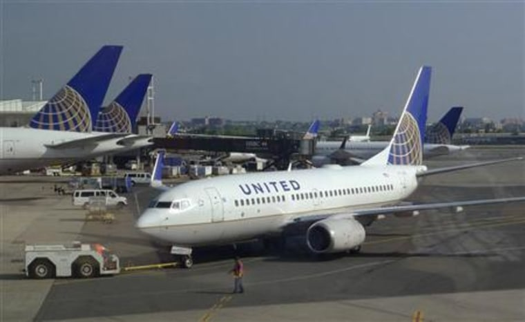 A United Airlines airplane is towed to a gate after arriving at Newark Liberty International Airport