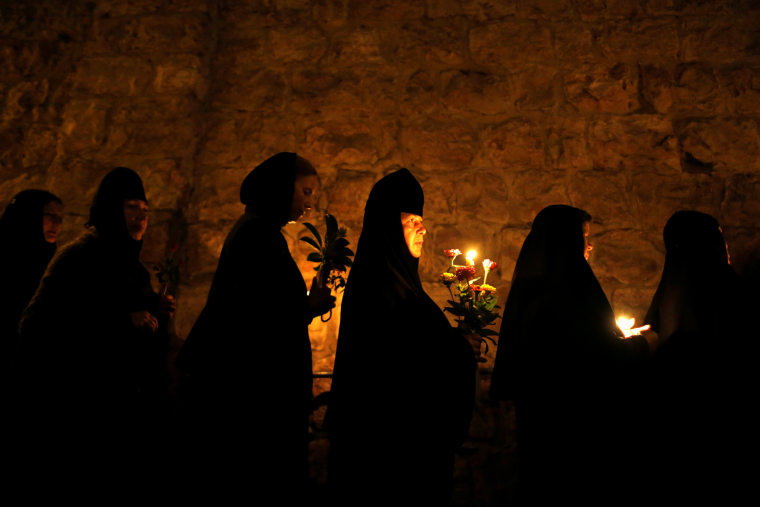 Image: Orthodox Christian nuns take part in an annual procession along the Via Dolorosa in Jerusalem's Old City