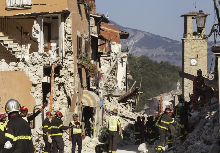 Image: Firefighters work in Amatrice, were more than 20 people were killed in the earthquake.