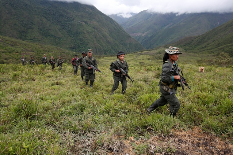 Image: Members of the 51st Front of the Revolutionary Armed Forces of Colombia (FARC) patrol in the remote mountains of Colombia