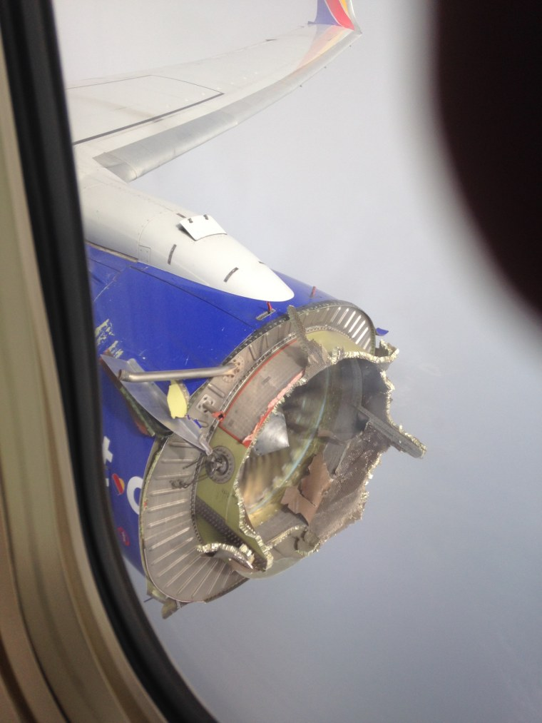 This photo taken by a passenger on Southwest Flight 3472 shows a damaged engine after an engine failure that occurred at cruising altitude Saturday,  Aug. 27, 2016.