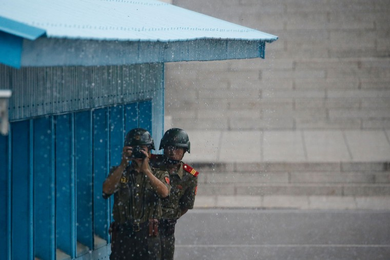 North Korean soldiers keep watch toward the South side at the truce village of Panmunjom