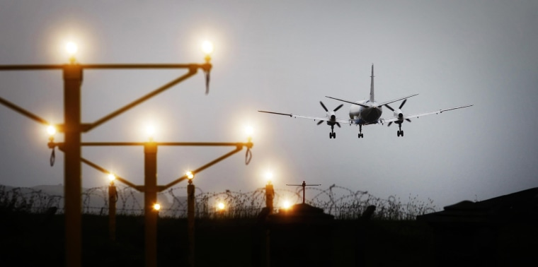 Image: A plane lands at Glasgow Airport in Scotland on May, 25, 2011.