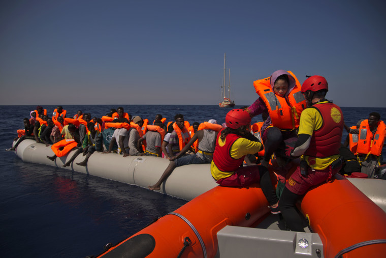 Image: Migrants from Nigeria fleeing Libya are rescued by emergency teams