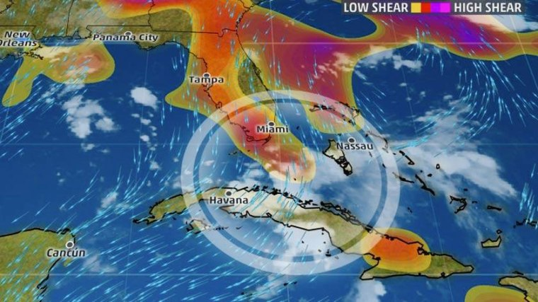 Image: Northerly wind shear affecting 99-L on Sunday morning is shown in orange and red between South Florida and Cuba.
