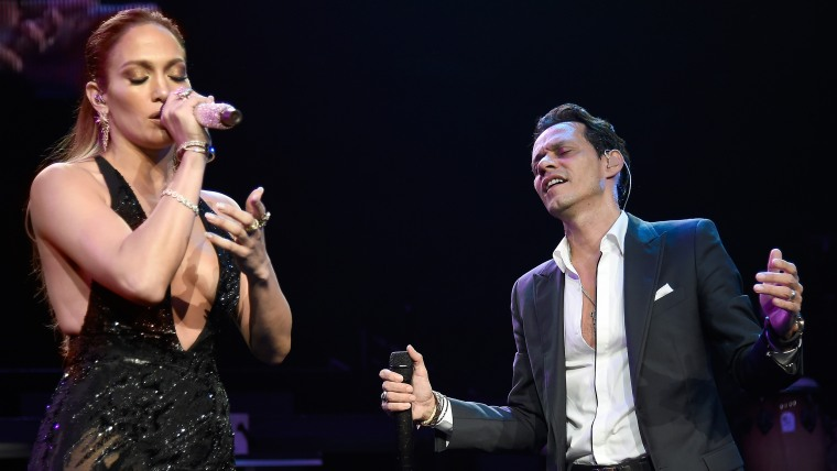 Jennifer Lopez performs onstage with Marc Anthony