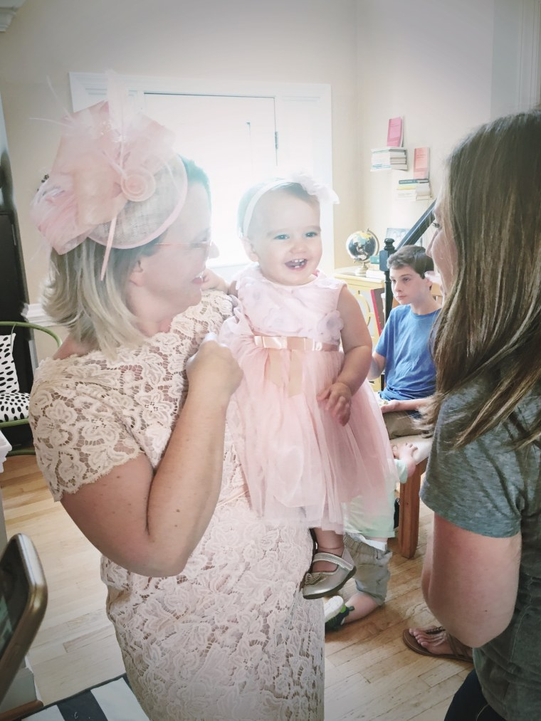 Ruby with her mom, Cher, dressed in pink for her first birthday party.