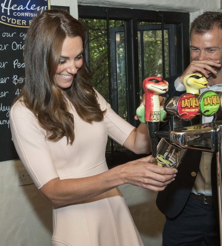 Duchess Kate pours a pint