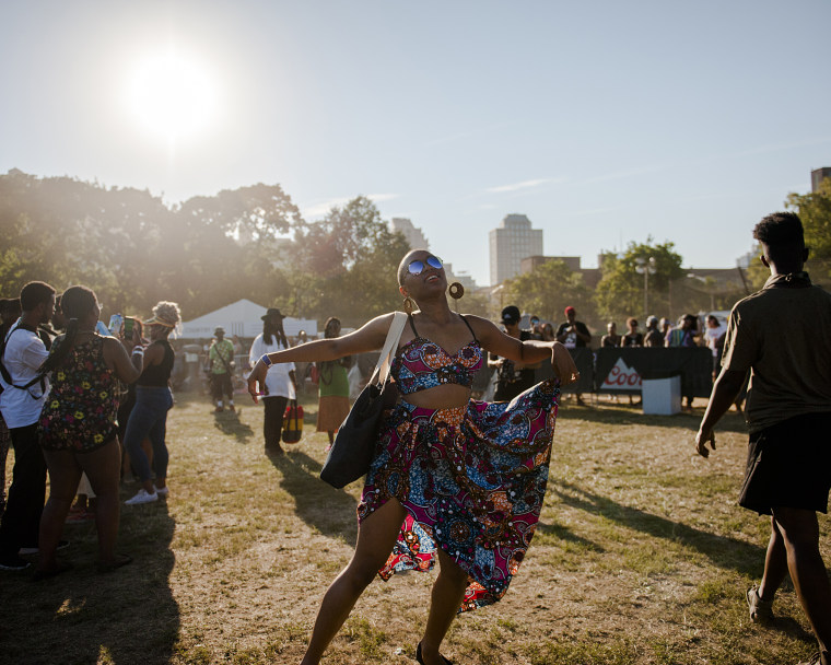 A festival attendee dances to the music at the Afropunk Festival in Brooklyn, NY.