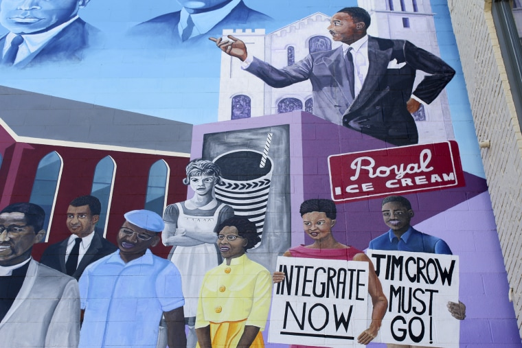 A civil rights mural in downtown Durham, North Carolina, commemorates various civil rights moments in Durham's history, including a sit-in at the Royal Ice Cream parlor and the integration of its public schools. Community funding helped push the creation of the mural in 2015. (Phillip Jackson/News21)