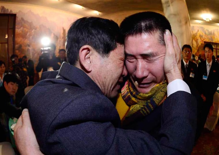 South Korean Park Yang-gon, left, embraces his brother Park Yang-Soo as they are reunited after being separated for 60 years.