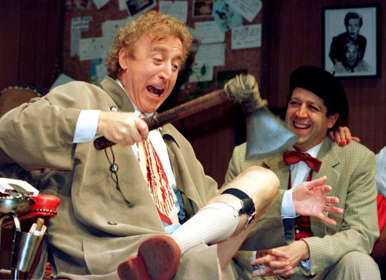 Image: American actor Gene Wilder (L) performs alongside compatriot Rolf Saxon, during the rehearsal of a scene from Neil Simon's