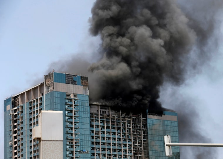 Image: Smoke rises after a fire broke out in a building at Al Maryah Island in Abu Dhabi