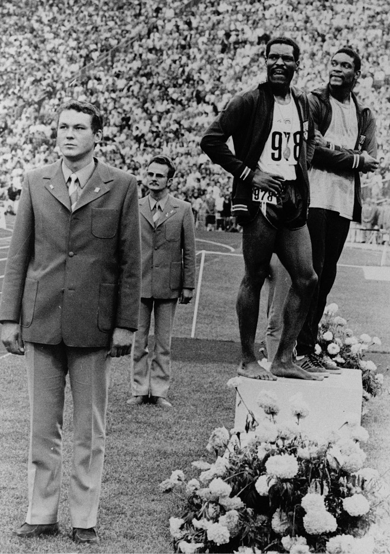 Gold medal winner Vincent Matthews, right, and silver medal winner Wayne Collett stand at ease and sideways to the flag as the U.S. national anthem was played in a protest of U.S. civil rights policies at Munich Olympic Stadium on Sept. 7, 1972.