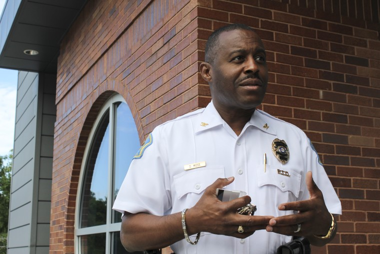 Ferguson Police Chief Delrish Moss speaks outside of the city's downtown police building.