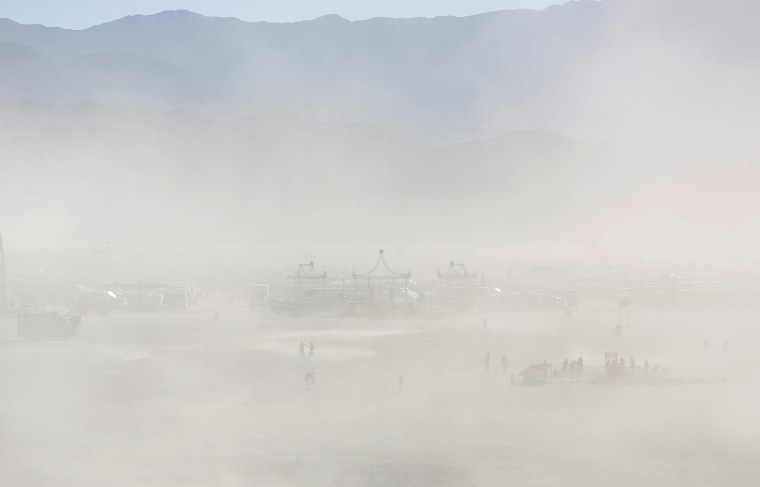 Image: People gather for the 30th annual Burning Man arts and music festival in the Black Rock Desert of Nevada