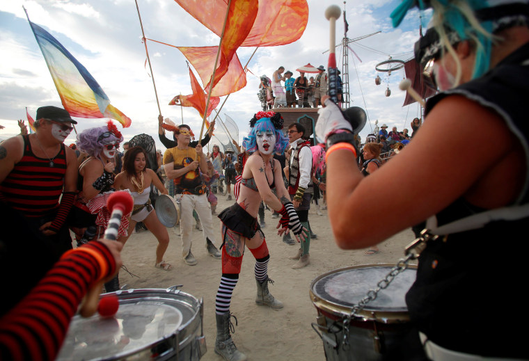 Image: Members of the Trash Kan Marchink Band perform at Burning Man