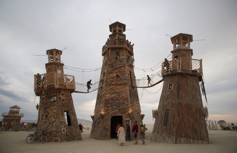 Image: Participants walk through an art installation at Burning Man