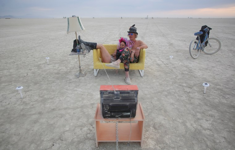 Image: Jody Friedman and Jeff Montgomery sit infront of the Playa TV on Tuesday
