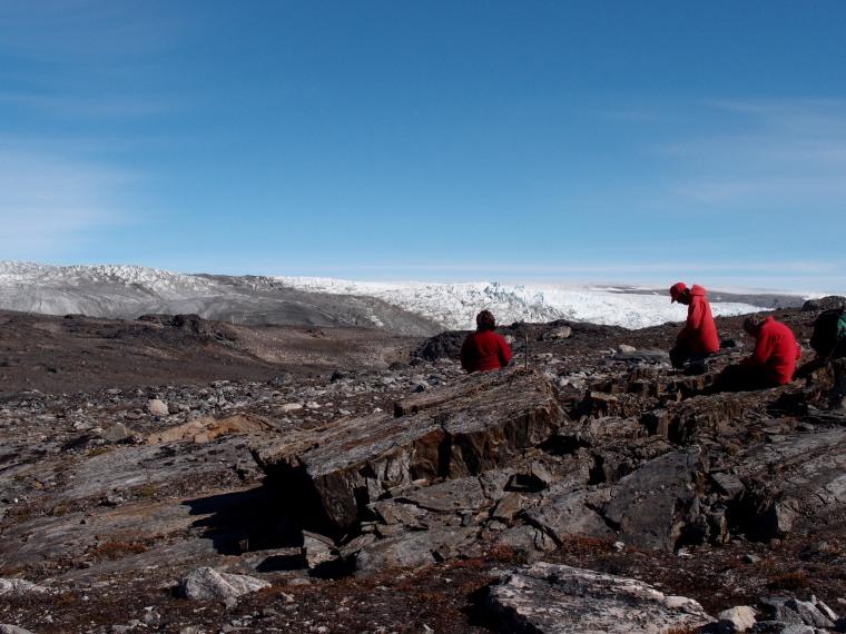 Associate Professor Vickie Bennett, Professor Allen Nutman and Dr Clark Friend, examine the rocks in Greenland.