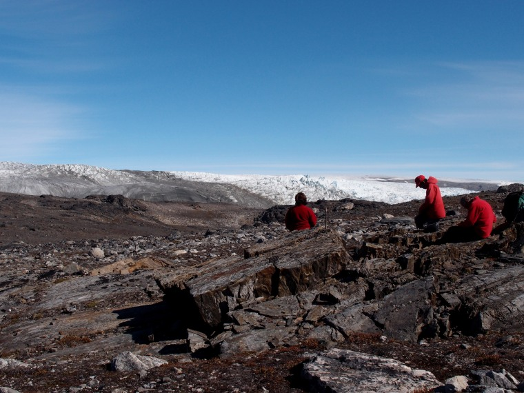 Associate Professor Vickie Bennett, Professor Allen Nutman and Dr Clark Friend, examine the rocks in Greenland.
