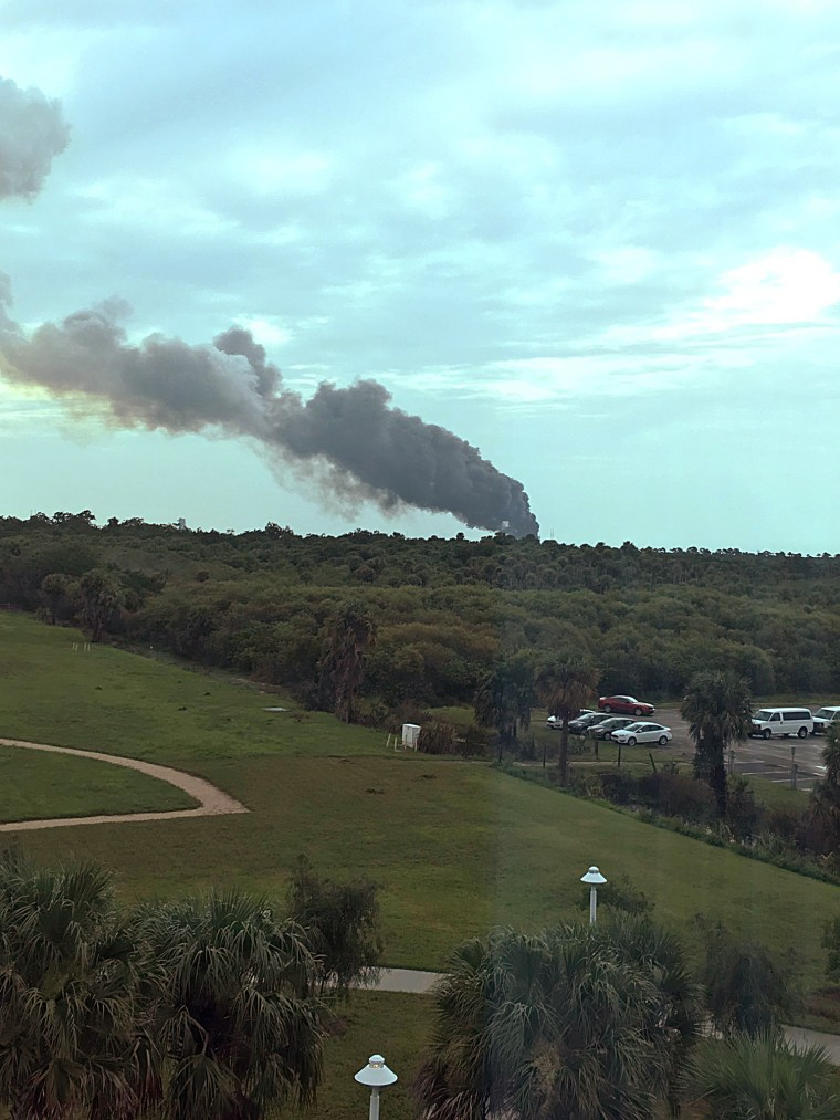 Black some rises from the launch complex at Cape Canaveral, Florida, where a SpaceX Falcon 9 was scheduled to launch.
