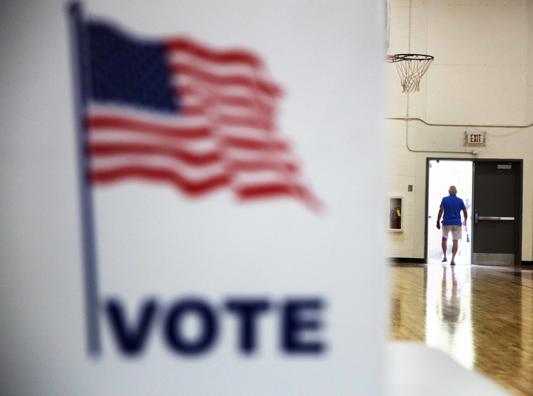 Image: A voter leaves a polling site after casting a ballot