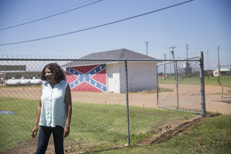 Gloria Dickerson, who first integrated Drew's public schools in 1965, stands in front of a shed at North Sunflower Academy, a private school where many white students enrolled after integration. Today the academy is the town'??s only high school. Out of 100 K-12 students at the school, only one student is black, according to the National Center for Education Statistics. The town is 81 percent black.
