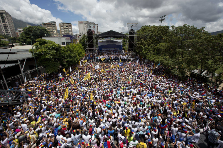 "Demonstrators take part in the ""taking of Caracas"" march in Caracas, Venezuela, Thursday, Sept. 1, 2016."