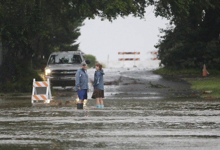 Image: Residents check on a flooded street  as Hurricane Hermine nears the Florida coast