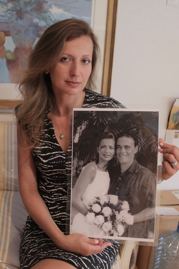 Image: Monica Iken-Murphy, whose husband Michael Iken died on 9/11, holds a photo from their wedding day in 2000, on Sept. 1, 2016 in New York.