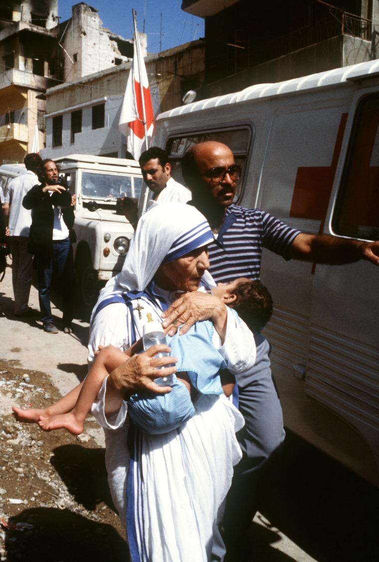 Peace Nobel Prize Mother Teresa hugs a c