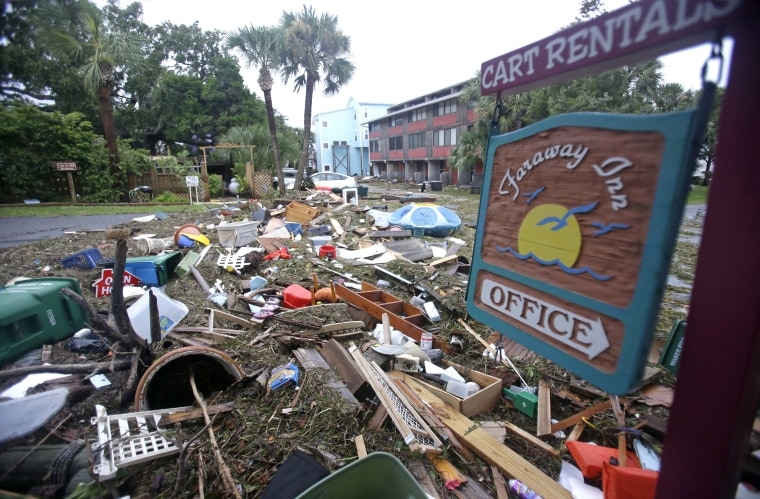 A street is blocked from debris washed up from the tidal surge of Hurricane Hermine Friday in Cedar Key, Florida.