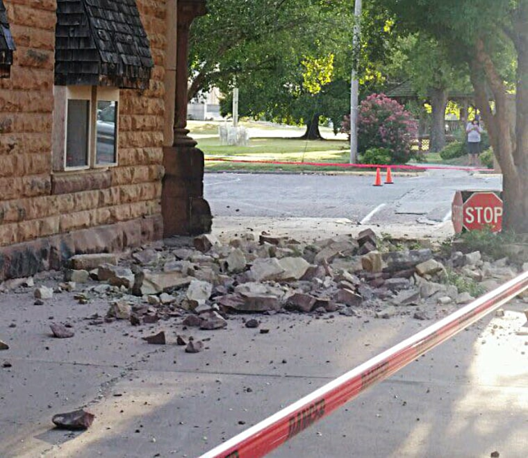 Rubble covers a sidewalk in Pawnee, Oklahoma, after an earthquake.