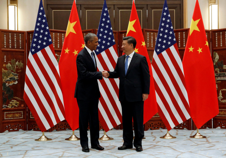 Image: China's President Xi Jinping and U.S. President Barack Obama shake hands before a bilateral meeting ahead of the G20 Summit, in Ming Yuan Hall at Westlake Statehouse in Hangzhou